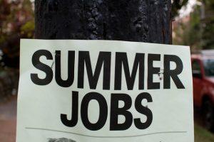 A sign that reads: Summer Jobs