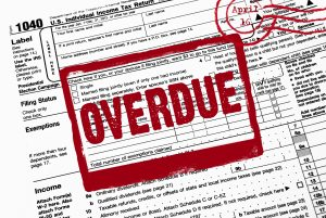 A 1040 tax return with the word 'Overdue' stamped on it.